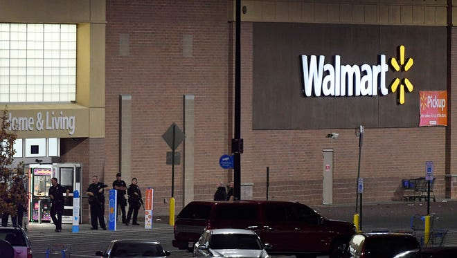 Police guard the front entrance to Walmart where a shooting occurred inside the store, Wednesday, Nov. 1, 2017, in Thornton, Colo.