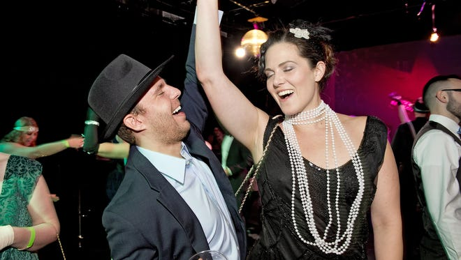 The Know Theatre rang in the 2018 with their annual NYE Speakeasy party. Revelers enjoy themselves on the dance floor.