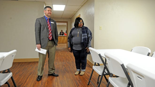 Eric West, district 1 councilor, left, and DeAndra Chenault, district 2 councilor, take a tour of the remodeled Kemp/Sunnyside Center Thursday, Jan. 4, 2018 during an open house.