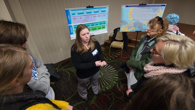 Megan Davidson, a biological oceanographer with the Bureau of Ocean Energy and Management, Division of Environmental Assessment talks to people about the national outer continental shelf oil and gas leasing program during a meeting in Dover.