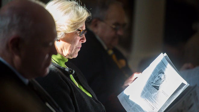 Vermont state Sen. Jane Kitchell, a Democrat from Caledonia, Vt., reads literature about the history of cannabis distributed by state Sen. John Rodgers, a Democrat from Essex/Orleans, Vt., not pictured, before the Senate voted to legalize marijuana at the statehouse in Montpelier, Vt., on Jan. 10, 2018.
