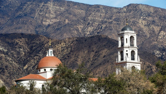 Mountains blackened by the Thomas Fire last December form a backdrop for Thomas Aquinas College near Santa Paula. The college acquired 700-plus acres recently to expand the campus, though the school doesn't plan on adding any additional structures or students at this time.