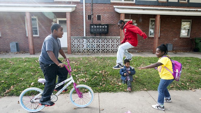 Children play outside the buildings at Lee Walker Heights, the oldest public housing development in Asheville.