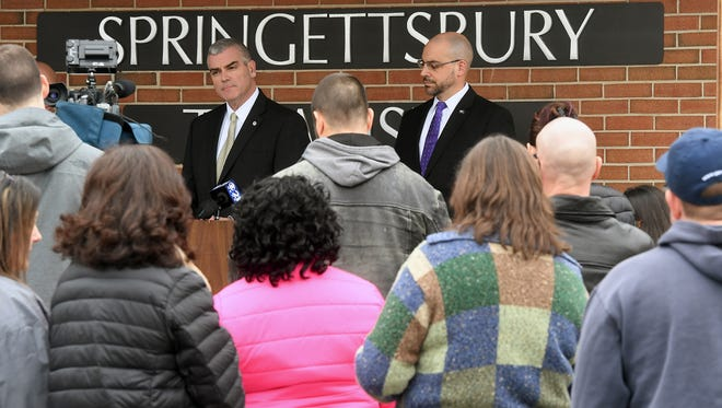 Central York School district superintendent Michael Snell, left, and York County district attorney Dave Sunday in front of parents and students during a press conference at Springettsbury Township Police Department about the status of the investigation of threats against Central York School District on Sunday.