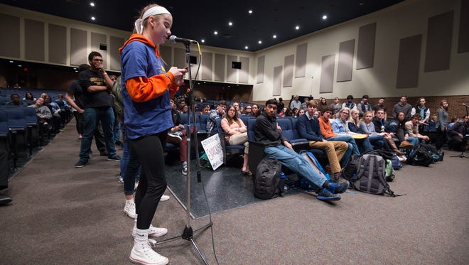 Gail Conk, 17, a junior at Caesar Rodney High School, asks a question to a panel of local representatives during a town hall meeting moderated by the school's AP Comparative Government teacher.