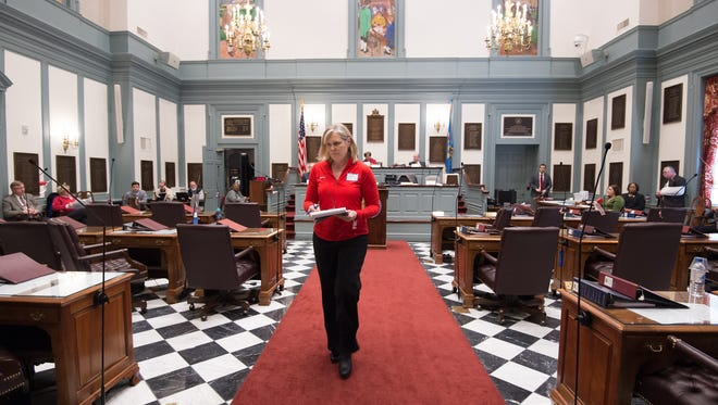 Kristen Ehlman of Middletown walks back to her seat after giving her testimony to the Senate Judicial Committee concerning bump stocks.