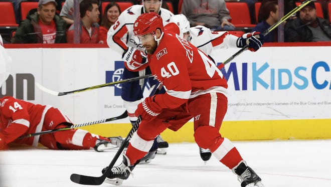 Red Wings center Henrik Zetterberg (40) skates with the puck in the second period of the Wings' 1-0 loss on Thursday, March 22, 2018, at Little Caesars Arena.