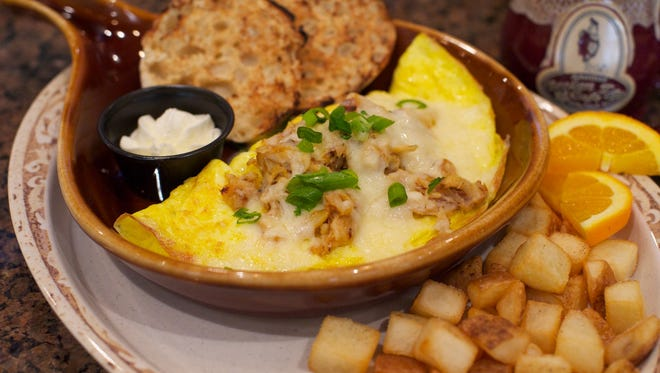 "Another Broken Egg Cafe's ""The Floridian"" omelet features fresh crab meat with melted Monterey Jack cheese."