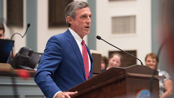Gov. John Carney gives his remarks during a ceremony to honor Bernard Brady, secretary of the Delaware State Senate, in the Senate during the last day of session at Legislative Hall in Dover.