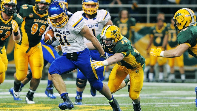 SDSU's Zach Zenner (31) rushes with the ball during the second half of an FCS playoff game against NDSU on Saturday, Dec. 6, 2014, in Fargo, N.D. The Bison defeated the Jackrabbits 27 to 24.