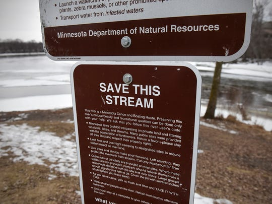 Signs highlight threats to water quality Wednesday, Jan. 25, at the confluence of the Sauk and Mississippi Rivers.