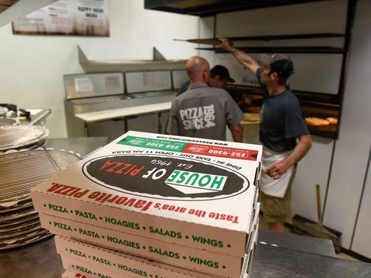 Boxes are ready to be filled with freshly-baked pizzas Tuesday, Aug. 1, at House of Pizza in downtown St. Cloud.