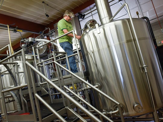 Brewmaster Chris Laumb checks on some equipment Wednesday, Nov. 8, at Beaver Island Brewing Co. in St. Cloud. Beaver Island expanded their distribution to the Twin Cities in February, nearly doubling the number of retailers they supply.