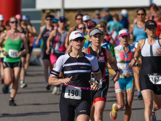 Competitors leave the starting line Saturday, May 26, during the Apple Duathlon in Sartell.