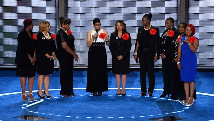 Members of Mothers of the Movement take the stage during