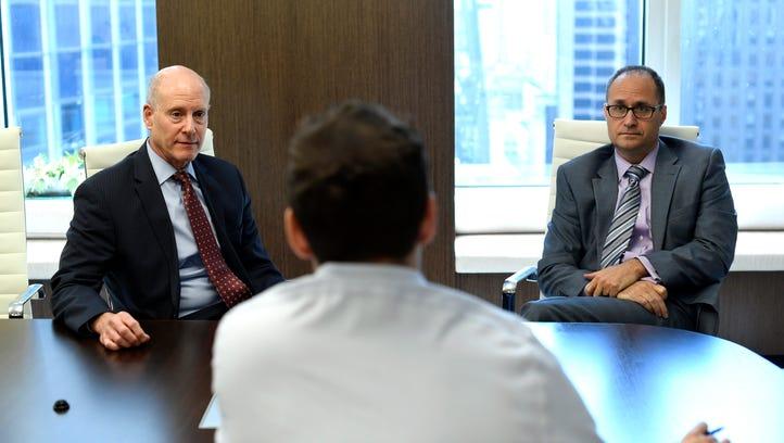 Attorneys Marc Press, left, and Jordan Fisch talk about
