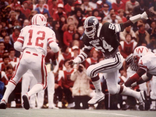 Michigan State linebacker Carl Banks readies to tackle a Wisconsin player in this undated photo.