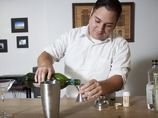 Mixologist Mike Pritchard prepares a drink called Air