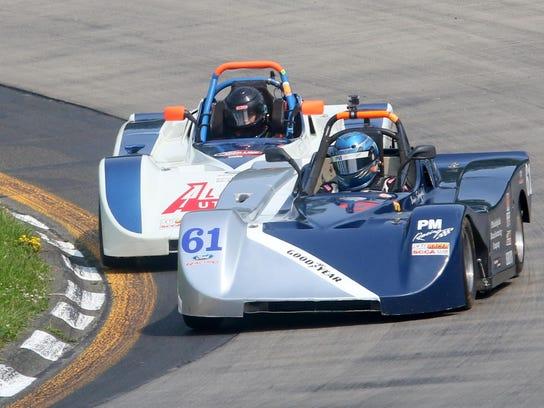 Brian Schofield, in the No. 61 SRF Ford, leads Scott