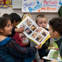 "Cheryl Smith, Tulare County public defender and author of a book about dogs' impact in mental health court, shares her dog Buster with kindergartners at Crestwood Elementary School on Tuesday, March 3, 2015. Each of the students received a copy of her book ""Oliver's Heroes: The Spider Adventures."""