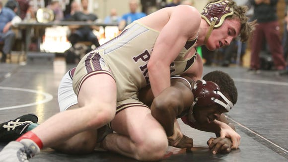 Iona's Colin Realbuto on his way to defeating Ossining's Zachery Bonner in the 138-pound weight class at the Westchester County Wrestling Championship at Yonkers High School Jan. 20, 2018.