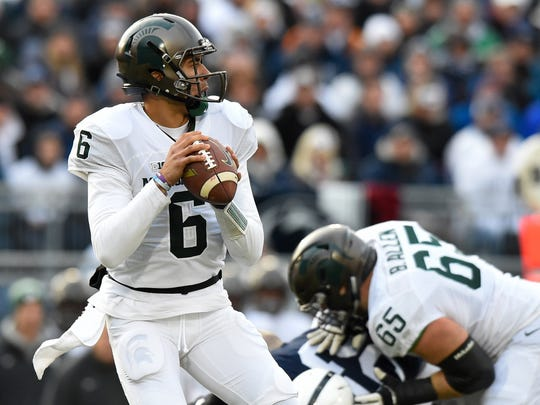 Nov 26, 2016; University Park, PA, USA; Michigan State Spartans quarterback Damion Terry drops back to pass against the Penn State Nittany Lions during the first quarter at Beaver Stadium.
