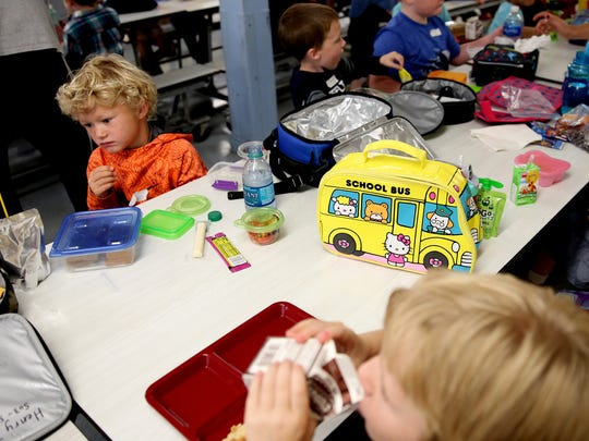 Kindergarteners eat lunch at Liberty Elementary School in Salem on Wednesday, Sept. 13, 2017. Wednesday was the first day of school for kindergarteners in Salem-Keizer.