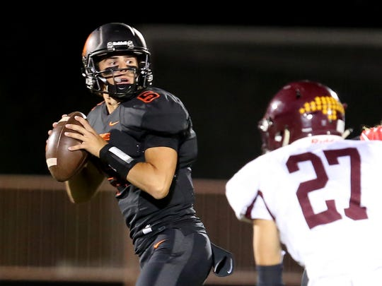 Sprague's Spencer Plant (5) looks to pass in the Forest Grove vs. Sprague football game at Sprague High School in Salem on Friday, Oct. 6, 2017.