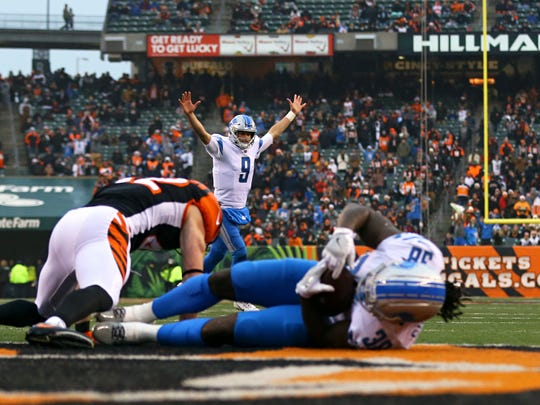 Lions quarterback Matthew Stafford (9) reacts to the touchdown scored by running back Tion Green (38) against the Bengals in the second half of the Lions' 26-17 loss on Sunday, Dec. 24, 2017, in Cincinnati.