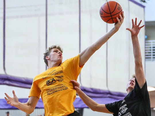 Fort Wayne Blackhawk Christian's Caleb Furst rebounds