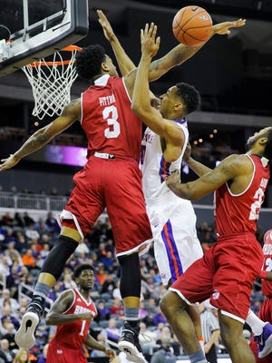Bradley Braves guard Antoine Pittman (3) blocks a shot from Evansville Aces guard Ryan Taylor (0) during their game at the Ford Center in Evansville, Wednesday, Jan. 4, 2017. Bradley beat Evansville 74-63.