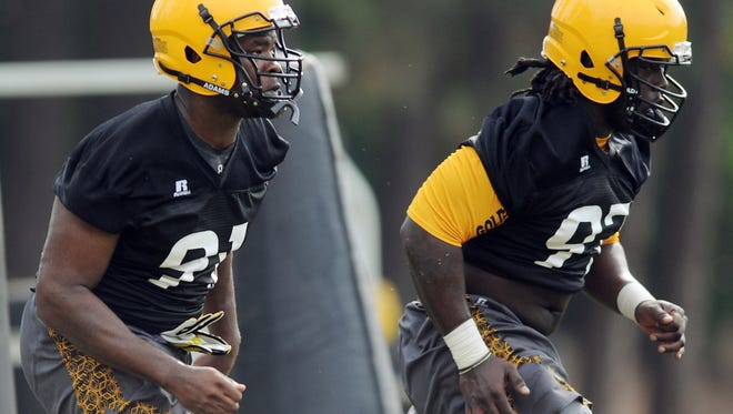 Univerisity of Southern Mississippi's defensive linemen Michael Smith, left, and Rakeem Nunez-Roches perform a defensive drill during football practice at the University's Joe P. Park Practice Facility.