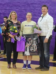 Albion College senior Tierra Orban (center) with her