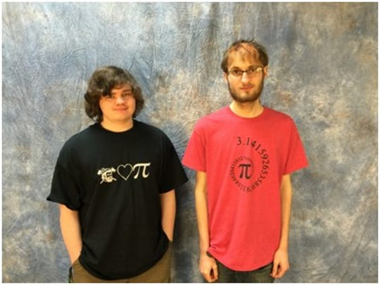Luke Pagel and Carl Martens show off their Pi Day T-shirt designs.
