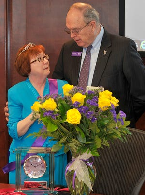 Terry Welch, left, assistant to the chancellor at Western Carolina University, receives recognition from Ed Broadwell, chairman of the WCU board of rrustees, during a light-hearted moment in the board's June 3 meeting.