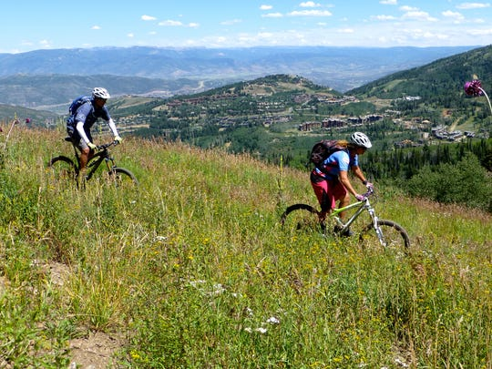 Shaun Raskin, right, and Tim Morris, both of Park City, ride the scenic trails at the ski resorts.