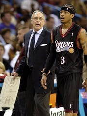 Sixers coach Larry Brown talks with Allen Iverson during an April 2003 game in New Orleans.