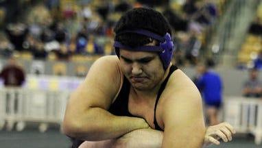 Clarksville's heavyweight (AAA) Bruno Reagan wrestles Blackman's Austin Wells.
