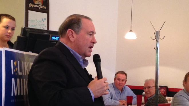 Republican presidential candidate Mike Huckabee talks to about 30 people gathered at Greggo's Pizza & Sandwiches in Mount Ayr.
