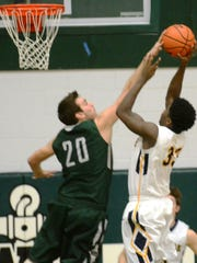 Novi's Jay Duarte (20) blocks a shot taken by Walled