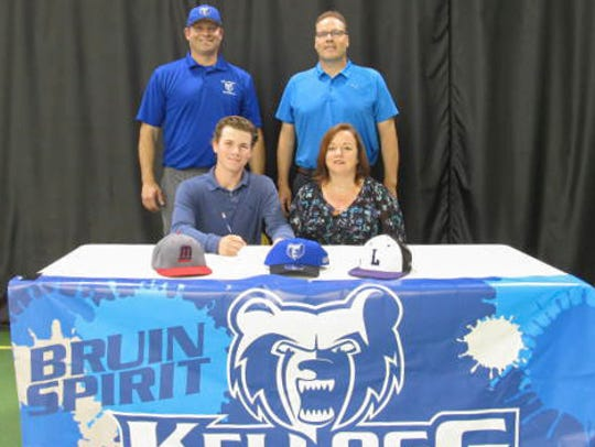 Lakeview High School graduate Zach Dehn (center) signs