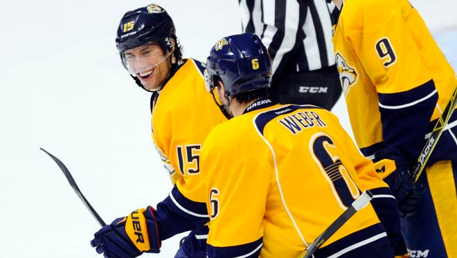 Predators right winger Craig Smith (15) celebrates with defenseman Shea Weber (6) after a goal during the first period against the Stars at Bridgestone Arena.