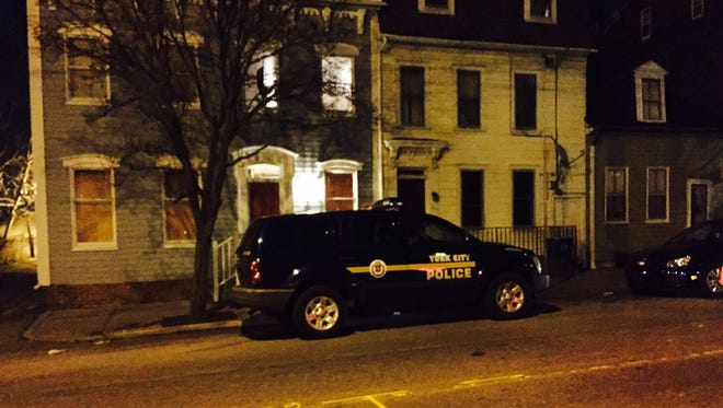 Police cars arrive on scene to a shooting on the 100 block of North Queen street in York city.