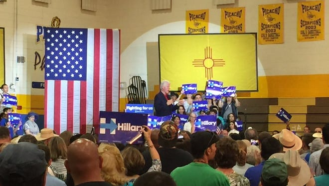 Former president Bill Clinton speaks at a rally for his wife and Democratic presidential candidate Hillary Clinton inside Picacho Middle School on Thursday.