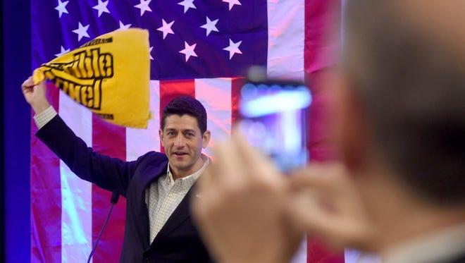 "House Speaker Paul Ryan twirls the Pittsburgh Steelers ""Terrible Towel"" before his speech at the Pennsylvania Republican delegate breakfast July 18, 2016."
