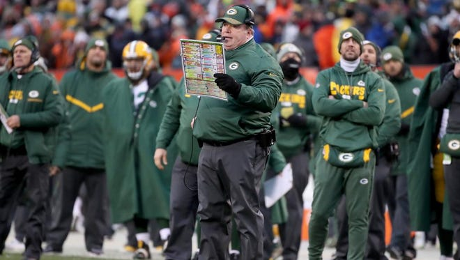 Green Bay Packers head coach Mike McCarthy calls a play in the fourth quarter against the Cleveland Browns on Dec. 10, 2017 at FirstEnergy Stadium in Cleveland.