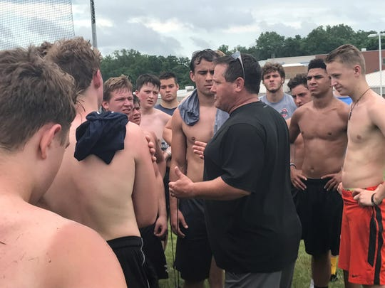 New Granville coach Justin Buttermore talks to his team June 20 following a conditioning session.