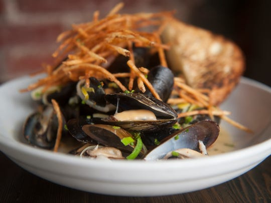 Moules frites with Belgain beer, melted lecks, mustard, and shoestring fries at Jerry's Bar in Philadelphia.