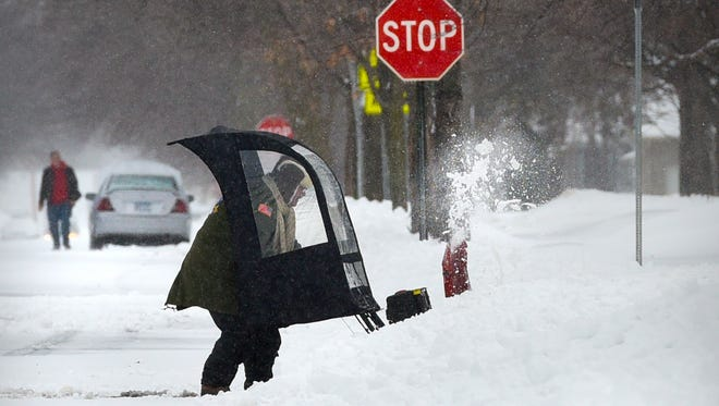 Snowblowers and shovels dotted St. Cloud Monday, March 5, as people started to dig out between waves of snow.