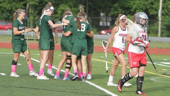 Yorktown celebrates after Katie Comerford scores the